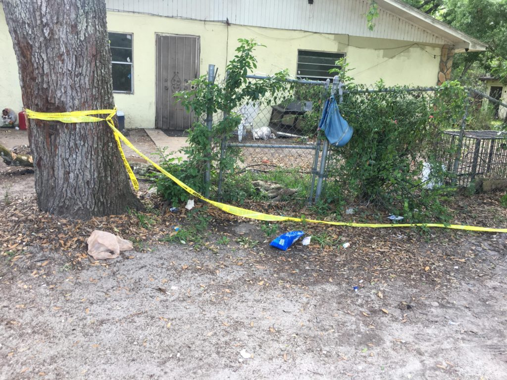Body found buried in yard during search for drugs, guns ...