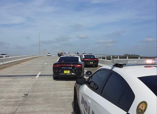 Police: Woman hospitalized after jumping from bridge